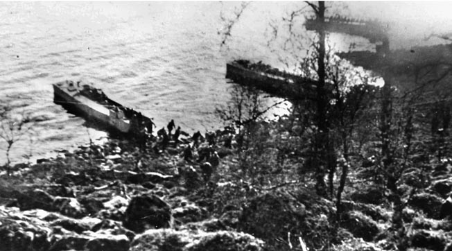 British landing craft with French and Norweigian soldiers aboard land north of Narvik.