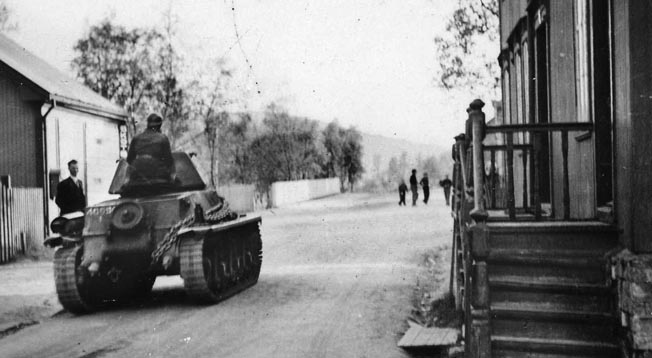 A French Hotchkiss H39 light tank rolls through the nearly empty streets of Narvik, which was taken from the Germans on May 28.