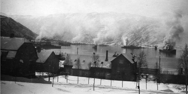 German merchant ships, filled with supplies for the invading forces, burn in Ofotfjord near Narvik after a battle with the British Royal Navy and warplanes, April 1940.