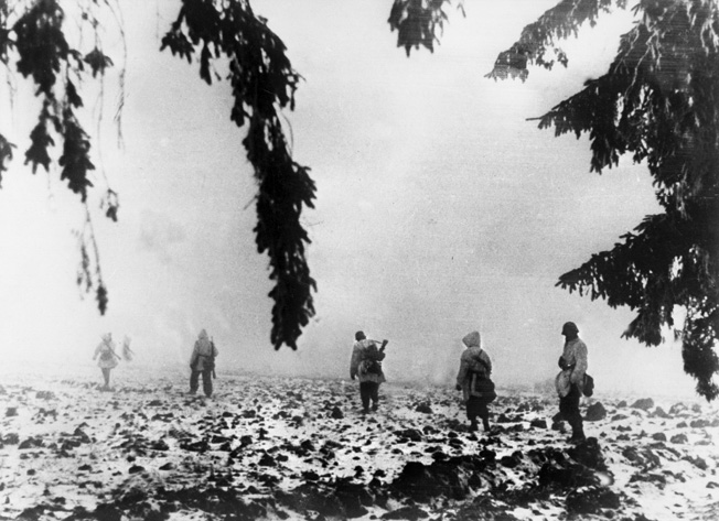 Wearing camouflage smocks, German infantry moves through the icy fog of a January morning in preparation for another counterattack.