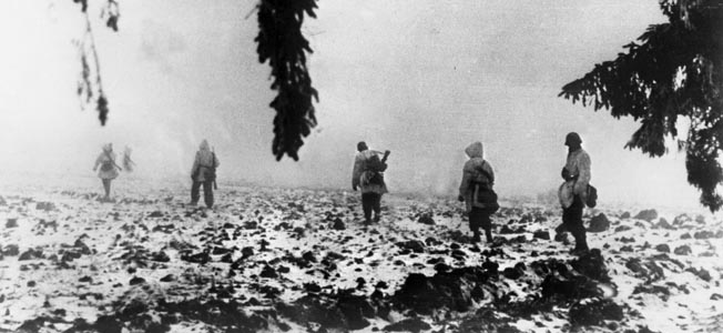 German volksgrenadiers in winter camouflage spread out as they advance through the fog during Operation Nordwind. The goal of the German offensive was to break through the U.S. Seventh Army's line and destroy its forces.