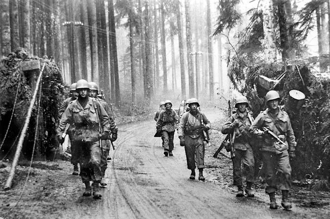 ABOVE: Soldiers of the U.S. Seventh Army move past a roadblock cleared by engineers in a forest in the Alsace region of France. The Seventh was stretched thin at the time of Nordwind because it had to extend its northern flank to cover ground previously held by the Third Army, which counterattacked German forces during the Battle of the Bulge. OPPOSITE: The men of Company C of the 62nd Armored Infantry Battalion stationed in the village of Bannstein fought desperately to buy time for Maj. Gen. Edward Brooks's VI Corps when attacked by lead elements of the 361st Volksgrenadier Division in the opening hours of Operation Nordwind