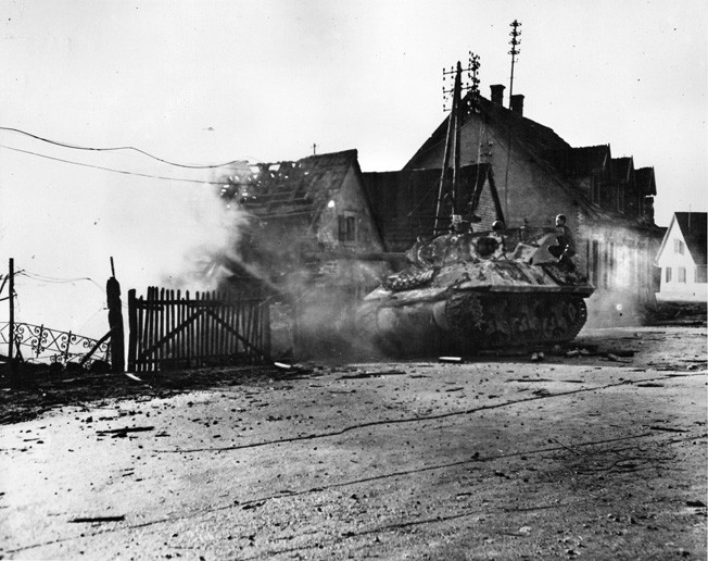 An American tank destroyer of Alexander Patch's Seventh U.S. Army fires on German positions in a factory at Kaltenhouse, a suburb of Haguenau.