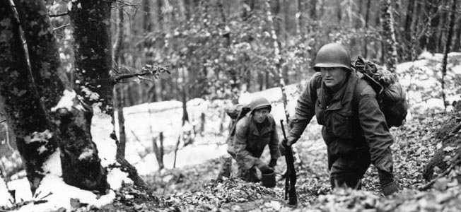 The survivors of Company C retreated to safety over snow-covered ridges in the forests south of Bannstein under protective fire provided by U.S. field artillery.