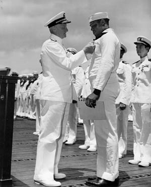 Mess Attendant Dorrie Miller became the first African American to receive the Navy Cross for his actions in the attack.