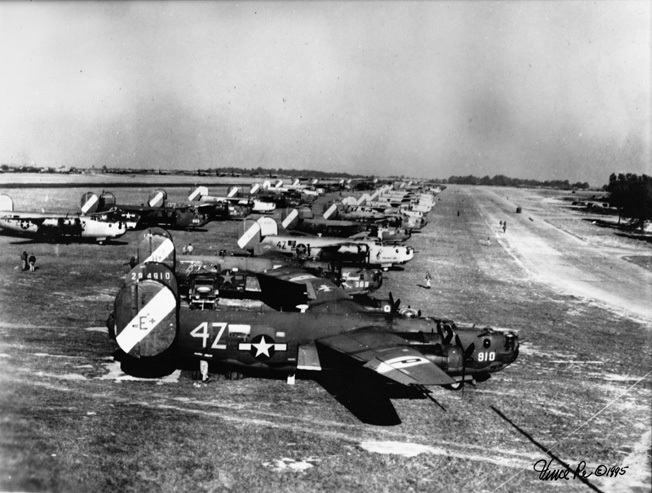 Bomber bases were anything but orderly. At Royal Air Force Rackheath, the 467th Bombardment Group kept its B-24 Liberators on soft grass. The bombers in the foreground in this image, including B-24H 42-94910, belong to the group's 791st Bombardment Squadron.