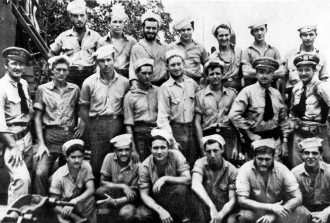 Lieutenant Thom (standing far left) with officers and men of PT boats 36 and 40.