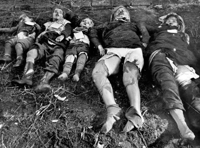 "The mutilated corpses of women and children lie in the East Prussian village of Metgethen in February 1945. After the German 5th Panzer Division briefly retook the area, an officer from the nearby Königsberg fortress expressed his horror: ""All were completely undressed and huddled up in a pile. Most of the children had had their skulls broken with a blunt object or their tiny bodies perforated with innumerable bayonet stabs."""
