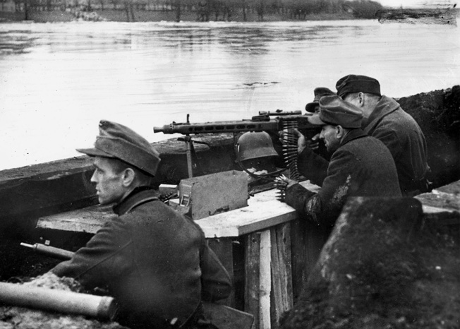 With the Oder River serving as an obstacle, a Volkssturm MG-42 machine-gun crew hopes to hold off the advancing Red Army.