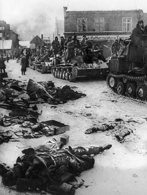 Riding atop a long column to tanks, Soviet soldiers pass through a city in East Prussia on their way to Berlin.