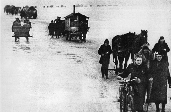 Taking all their possessions with them (including a small house mounted on a wagon), civilians in East Prussia flee from the advancing Soviet Army. German civilians would be as badly treated by the Soviets as Soviet civilians were by the German invaders in 1941.