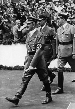 Hitler is accompanied by Albert Speer (right), general building inspector for Berlin, as well as Hermann Esser (center), vice president of the Nazi Reichstag in January 1937.