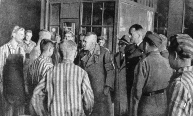 "The only image of Speer (fourth from right) visiting a concentration camp (Mauthausen). Speer claimed not to know about the existence of Hitler's ""Final Solution."""