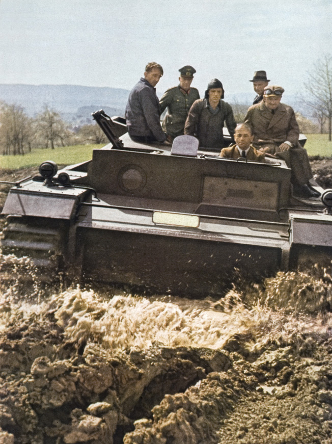 In this photo published in Signal magazine in August 1943, Albert Speer is shown at the wheel of a prototype tank.