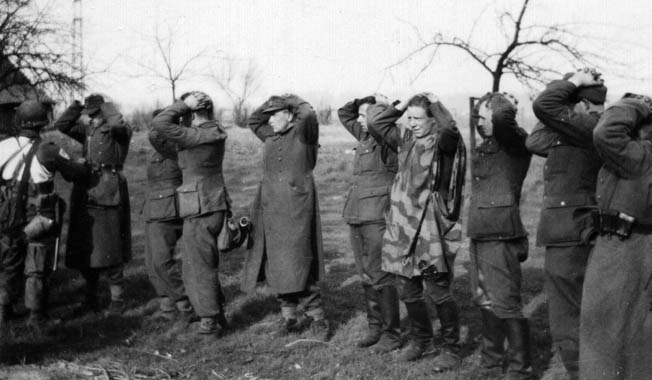American airborne troops round up German prisoners during the operation.