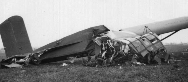 Not all landings were happy ones. Here a CG-4A lies crumpled in a field near Wesel. Many glider troopers were killed or seriously wounded in these crash landings or when enemy antiaircraft fire brought them down.