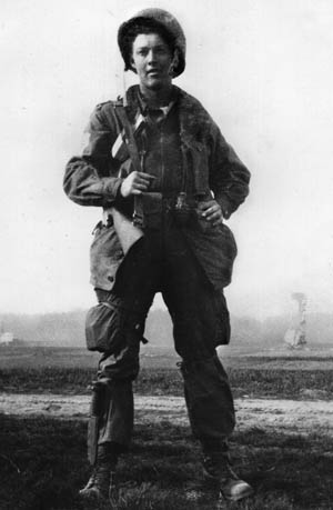 """Tom Warner's good friend, Curtis J. """"Goldie"""" Goldman—brash, cocky, and fearless—stands with a Thompson submachine gun slung over his shoulder on a Varsity LZ."""