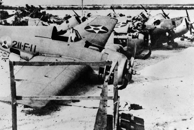 Seven of the destroyed F4F Wildcats of VMF-211 on Wake after the island fell. The plane in the foreground was flown by Elrod during his December 11 attack that sank the destroyer Kisaragi.