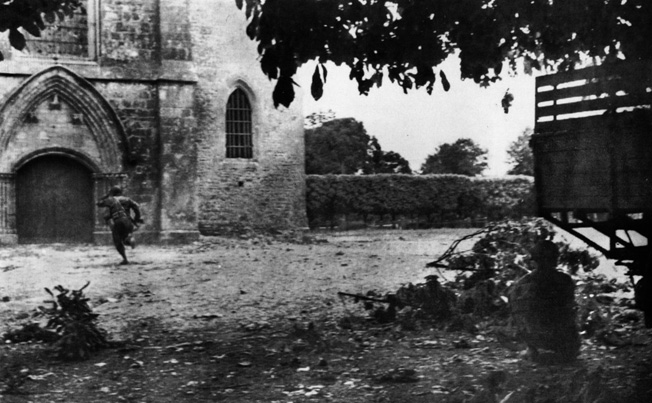 Troopers of the 505th PIR run for the door of the church in Sainte-Mère-Église as German artillery lands in the town on June 6, 1944.