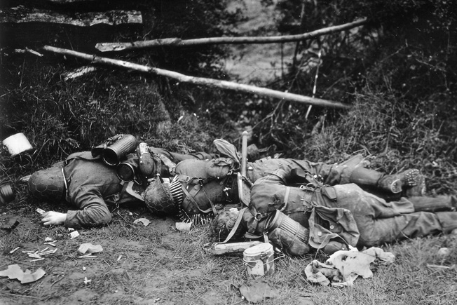 The bodies of three German soldiers killed in the fighting in Normandy.