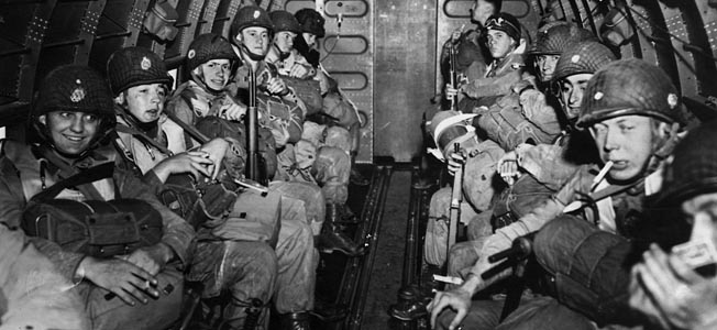 "Their faces displaying a variety of emotions, these paratroopers from the 101st Airborne prepare to take off in a C-47 ""Skytrain"" on D-Day."