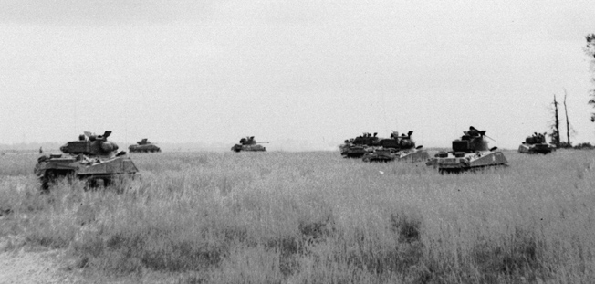 British armoured units were well equipped with U.S. M4 Sherman tanks, shown here crossing an open wheat field in the Odon Valley near Evrecy, July 16.