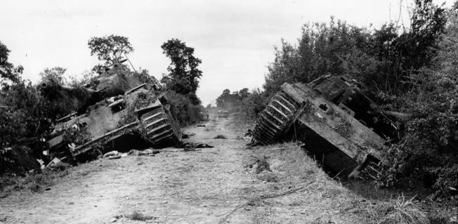Two German Mark V Panthers of the Panzer Lehr Division lie destroyed after British attacks on July 13, 1944.