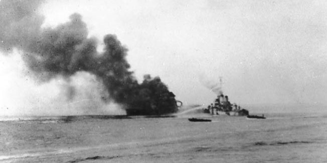O'Brien comes to the aide of the stricken USS Ward, December 7, 1944, at Ormoc Bay, Leyte. Exactly three years earlier, the Ward had attacked a Japanese submarine trying to enter Pearl Harbor. William Outerbridge, captain of the O'Brien, was then skipper of the Ward.