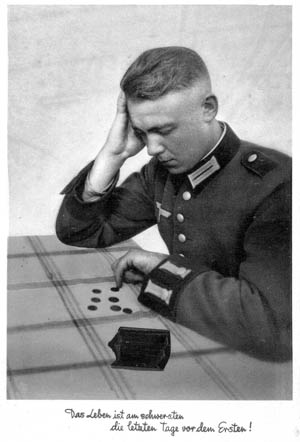 """A young Army soldier counts his few pfennigs at the end of the month and prior to pay day. He wears his Waffenrock field-green formal """"walking out,"""" or parade, dress uniform with its elaborate cuffs. Before being abolished at the outbreak of WWII, these tunics were modeled after the old Imperial Army uniform and often hand-tailored for their owner. The various color tabs, braid, insignia, and other decorative trim also served to identify rank and branch of service."""