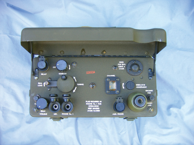 The control panel of the BC-1000 transmitter/receiver, with the hinged cover up.