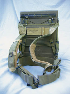 "The harness attached to the BC-1000 radio unit is imprinted with ""Mid West Duck & Canvas Co 1943."" Note the thick felt pads that have been slipped over the shoulder straps. The felt cushioned the shoulders, vastly improving the comfort of the harness."