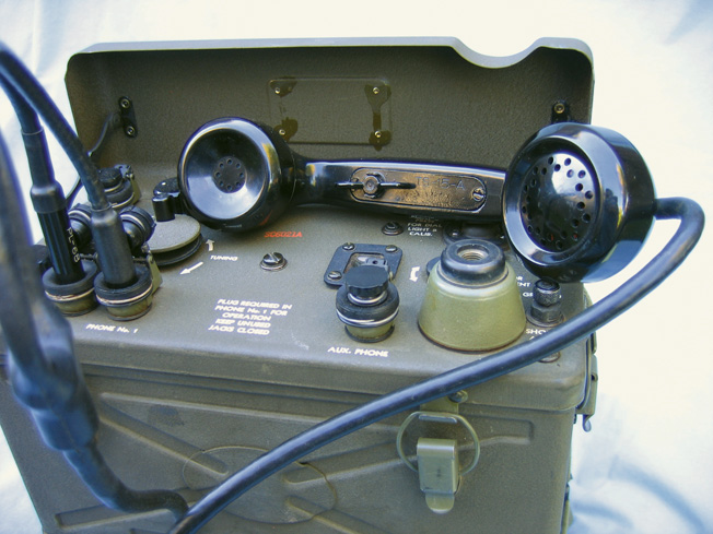 "The telephone-like Handset TS-15-A. Note the ""butterfly"" switch that, when rotated either direction, activated the transmit circuit."