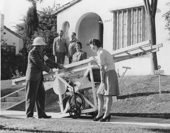 Being the most susceptible to Japanese attack, the West Coast was the best prepared. Here a Civil Defense warden shows Southern California civilians how to use a homemade fire-fighting apparatus.