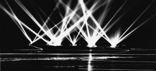 Like the cities of England and Germany, the West Coast (such as here at San Pedro, California) was well equipped with powerful searchlights and batteries of antiaircraft guns.
