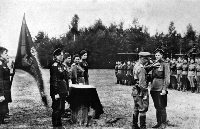 A member of the 46th Guards Night Bomber Aviation Regiment receives a medal during an awards ceremony.