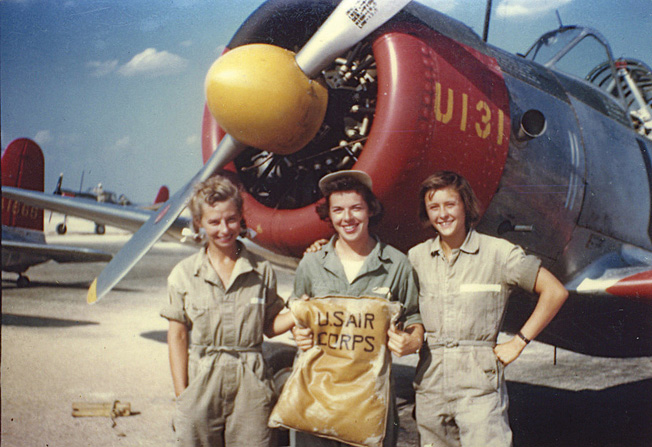 WASP trainees from class 44-W-8: (left to right) Mary Jackson Kinney, Anne Dailey Marshall, and Joanne Blair Martin in front of an AT-6 at Avenger Field in Sweetwater, Texas.