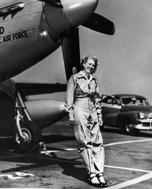 Jacqueline Cochrane, director of the WASP program during World War II, leans against the propeller of a P-51 in a postwar photo.