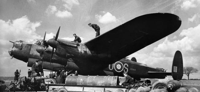 The Lancaster carried a heavier payload than either the American B-17 Flying Fortress or B-24 Liberator. This Lancaster of No. 467 Squadron, Royal Australian Air Force, is being loaded with bombs prior to a mission.