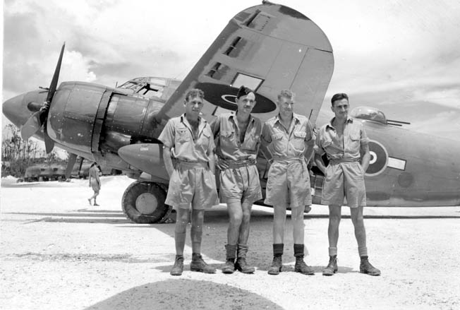 "An RNZAF crew poses in front of their Lockheed PV1 Ventura after returning from St. Georges Channel near Rabaul, where they were jumped by six to nine Japanese Zeros. As detailed in the story, the New Zealanders shot down three enemy aircraft and scored two other ""possibles."" The plane returned to Munda full of holes and with a crew member wounded in the ankle."