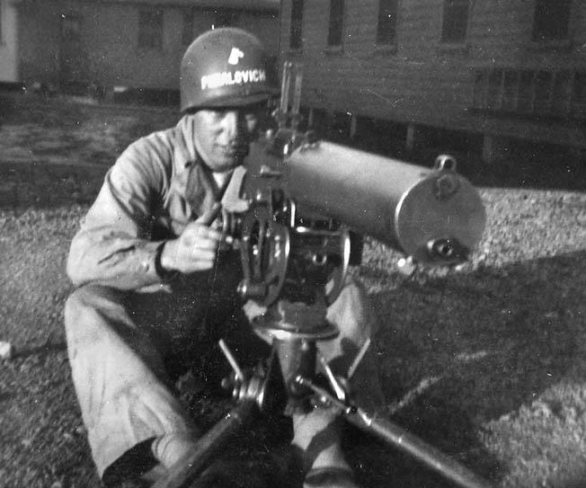 Private Puhalovich poses behind a .30-caliber water-cooled machine gun during basic training at Camp Adair, Oregon, 1943.