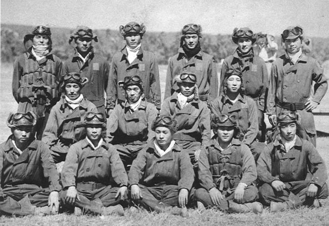Japanese pilots such as this group, many of whom were battle hardened and experienced after service in China, flew combat missions against the Americans in the skies above Guadalcanal from the huge Japanese base at Rabaul.