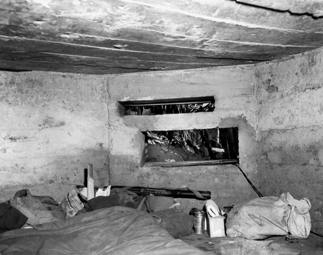 The interior of a Japanese pillbox that once housed an antitank gun near Agat Beach is shown in this photograph.