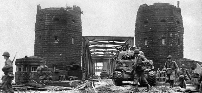 In March 1945, courage and luck enabled U.S. forces to seize an intact bridge over the Rhine at Remagen and thrust into Germany.