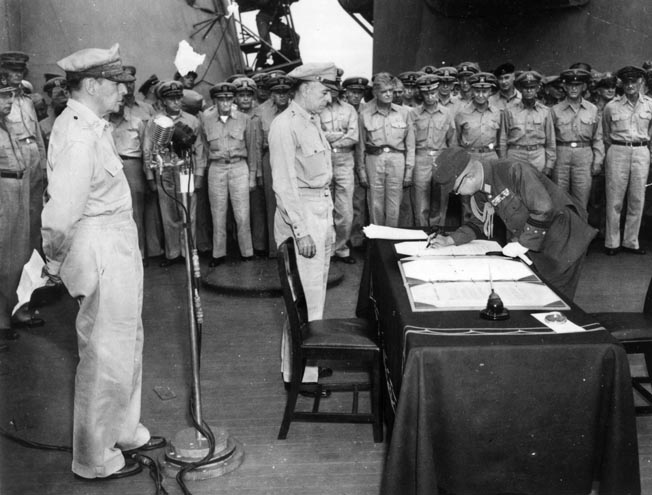 This photo of General Douglas MacArthur at the microphone was taken by Charles Restifo during the Japanese surrender ceremony aboard the USS Missouri.