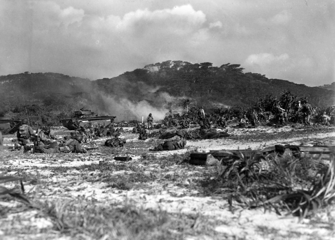 Troops of the U.S. Army's 306th Regimental Combat Team, 77th Infantry Division, come ashore at tiny Geruma Shima, one of the Kerema Retto group of islands near Okinawa,  during Operation Iceberg, March 26, 1945.