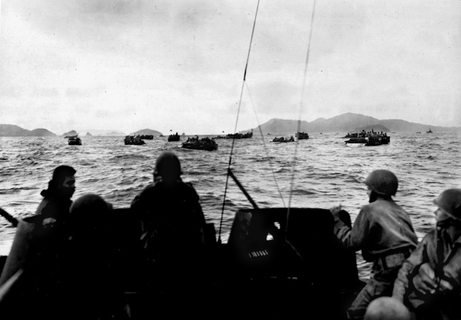 Amphibious tractors carrying the 1st Battalion, 305th Infantry, 77th Division, head for the beaches of Zamami Shima, March 26, 1945.