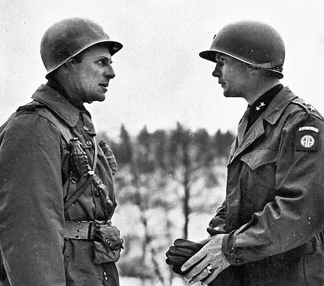 Generals Matthew Ridgway (left) and James Gavin, commander and assistant commander respectively of the 82nd Airborne Division, confer during operations in Normandy.