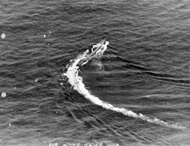 An unidentified Japanese Ro-class submarine takes evasive action on the surface of the Pacific Ocean. American antisubmarine tactics and weaponry took a heavy toll in Japanese submarines during the latter years of World War II.
