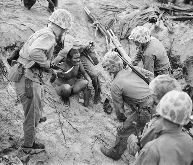A Marine corpsman gives medical aid to a wounded Japanese soldier at Roi-Namur. By early 1944, the American juggernaut across the Central Pacific was beginning to gain momentum.