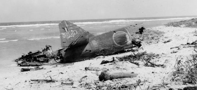 Heavy U.S. naval bombardment of Roi made a shambles of the airfield installations the Japanese had built on the small island and destroyed any planes that were present on the ground. This photo shows the remains of the tail section of a Japanese bomber after the pounding meted out to the airfield by Navy guns.